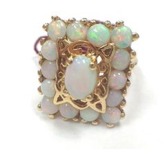 Vintage 1960s Large Opal and 14k yellow gold cocktail ring from Malena's Vintage Boutique at RubyLane.com