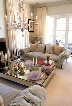 Beautiful and romantic. Check out the glam living room of Lisa Vanderpump decked out in comfy sofas, shimmering chandeliers and a mirrored coffee table
