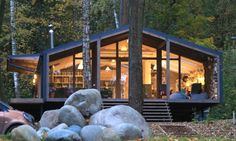 BIO Architects recently completed a modern modular cabin, proving yet again how beautiful homes can be affordable with the help of prefabrication. Commissioned by a young couple that desired a cost-effective home on the lake, the prefabricated cabin is the latest iteration in the Russian firm's line of modular Dubldom homes. The dwelling, located at Pirogovo Lake in the suburbs of Moscow, was installed in roughly ten days with minimal site impact.