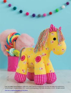 Learn how to make this carousel horse with a gorgeous candy-coloured mane -– every little girls best friend! You could use boyish, fun fabric to easily turn this pony into a perfect companion for every budding cowboy too. Finished size : 25cm (10in) tall x 23cm (9in) long. Pony Toy