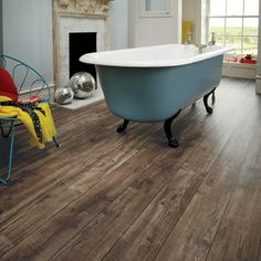 One of Knight Tile's most rugged looking products is our Mid Worn Oak plank, with a look of reclaimed timber and wide colour variation of nut brown and paler brown tones against a dark brown grain.