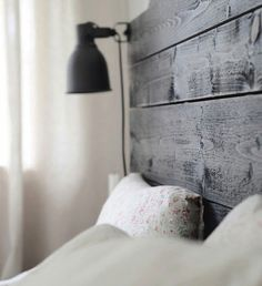 Spare room-Ikea Hektar Lamp clamped to a wood headboard. The simple metal lamp comes with a clamp, which makes it easy to attach to a headboard. Driftwood Headboard, Distressed Headboard, Home Bedroom, Bedroom Decor, Bedroom Ideas, Loft Bedrooms, Guest Bedrooms, Modern Home Office Furniture, Ideas Dormitorios