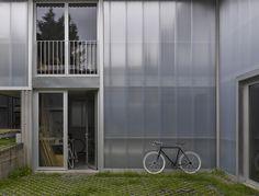 Yard House | Jonathan Tuckey Design, East Dulwich, London. Aluminium framework, door + window. facade finishing of Rodeca polycarbonate panelling.