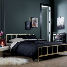 """<span class=""""copyHeader"""">go for the bronze.</span> Tweedy weave lives luxe in cool slate slicked with the warm gleam of bronze. Highlighting nubby texture with subtle graphic dimension, metallic foil print shines on 100% cotton square. Flips to solid slate. Do the math: CB2 low prices include a pillow insert in your choice of plush feather or lofty down-alternative (a rare thing indeed).<br /><br /><NEWTAG/><ul><li>100% cotton</li><li>Front: Bronze foil print</li><li>Back…"""