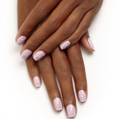 create a beautiful at home manicure with a bridal beautiful purple and pink dotted nail art design