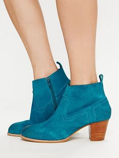 Teal ankle boots. $130, these are really cute. I can't wait to buy a new pair of kicks! <3