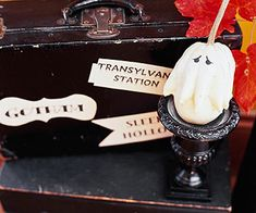 Gotham, Transylvania Station, and Sleepy Hollow aren't popular vacation spots. But souvenir stickers from these locales are a Halloween hit. Create your own suitcase labels by hand or on the computer. Embellish an old black traveling case with the labels. Friends will think a globe-trotting ghost has come for a visit to your house.