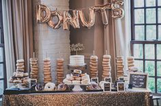 "Glam wedding donut dessert display -rose gold ""Donuts"" balloons with gold, sequin table linens and donuts {Enderes Photograph}"