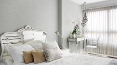 The bedroom is glam, with a mirrored bed and table and a cool lucite chair Colorful Apartment, White Apartment, Light Gray Bedroom, Mirror Headboard, Madrid, House Design, Interior Design, Studio, Furniture