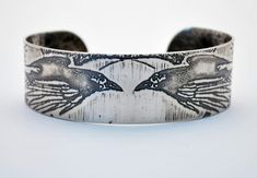 I've never seen one like it... sterling silver raven bangle silver raven by annamcdade.