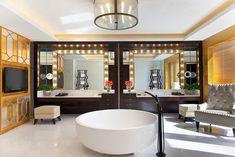 Bathroom interior- yellow, big circle tub, plasma tv, vanity mirror