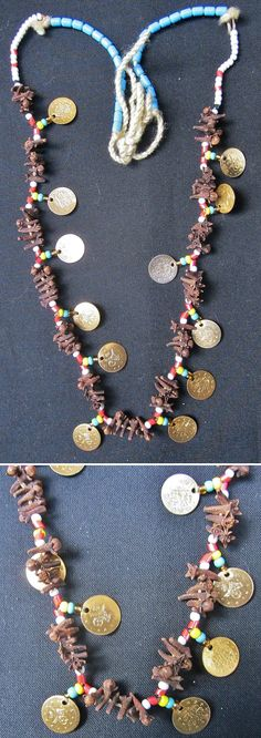 'Karanfilli gelin kolyesi'.  Bridal necklace from Tavas (south of Denizli).  With clove, glass pearls and small copper (imitation) coins.  Rural, early 21th century.  The clove is used because of its pleasant smell, which is symbolically transferred to the bride.  (Kavak Folklor Ekibi & Costume Collection-Antwerpen/Belgium).