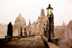 Watercolor painting of statues and architecture historic Charles Bridge over river Vtlava in the medieval city of Prague- Czech Republic