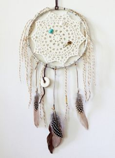 . crocheted dream catcher .. No instructions, but could use doily or other pattern for center.