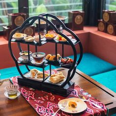 a beautifully presented high tea w. a delish selection of Thai savoury & sweet for a decadent afternoon.