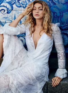 Gigi Hadid wears a v-neck lace gown for Vogue