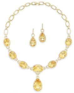 A citrine and diamond necklace and earring suite The graduated oval-cut citrines, within brilliant-cut diamond surrounds, separated by similarly set spacers, suspending a further pear-shaped citrine, to a plain link backchain, accompanied by a matching pair of earrings, diamonds approximately 4.60 carats total, earring length 3.9cm, necklace 40.0cm