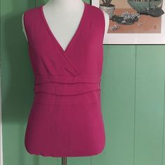☘Fuchsia Blouse Sleeveless with little button designs on both sides. Great Condition!! 65% Rayon & 35% Nylon. Stretchy!!  Cato Tops