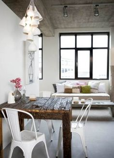 Concrete / love the ceiling. the whole room, actually.  Prop table against wall, couch against window.