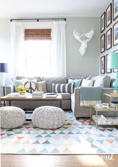 (NOTE: gray sofa, plus gray knit poufs from here - http://www.landofnod.com/pull-up-a-pouf-grey-variegated/f10938 )