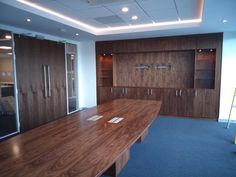 Finished Walnut Media Wall with Conference table