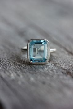 Sky Blue Topaz Emerald Cut Ring in Argentium Sterling Silver, Made To Order. $238.00, via Etsy.