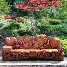 """I just had to post this photo of a hand made/hand carved bench with it's background scenery. The heart shaped piece on the front of the bench says, """"Sadie""""."""