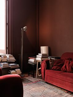 red sofa in a brown tone living room...
