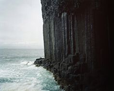 Sheer drop and black rock. dark cliff by Harry Cory Wright