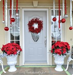 tamara you should do these ornaments between your posts on your porch! love the red wreath too