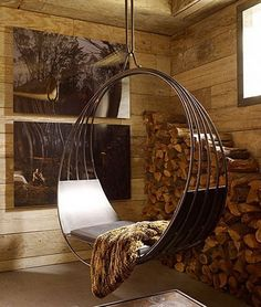 """HANGING SWING CHAIR AUX DEUX-   Custom designed swing chair.  Steel body with leather or fur cushion, & mounting brackets.  MEDIUM: Metal, Leather.  DIMENSIONS: Length- 4 ft. 6""""/ Depth- 18.5 """"/Height- 5 ft. 1"""".  DESIGN:  Erin Martin"""