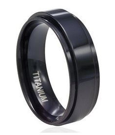 Glossy black titanium is the perfect complement to matte black stainless steel in this unique 8mm spinner ring. Titanium spinner rings for men are the latest addition to our selection of black rings, and can be worn as a fashion ring or wedding band. Men love this contemporary interpretation of the classic spinner ring! $32.95