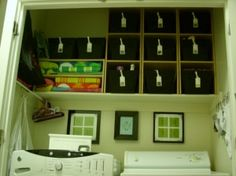 several good ideas for the laundry closet. love the tension rod and lost sock board. also homemade picture. very cute.