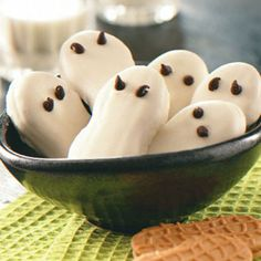 Ghosts!  Nutter Butter Cookies dipped in white chocolate with mini chocolate chips