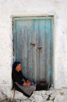 Yiayia, elderly, old lady, old wooden door, cracks, solitude, beauty, doorway, hands, beauty