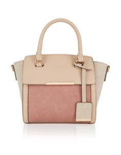 Small yet perfectly formed, the Lindy mini hand-held bag features three tonal…