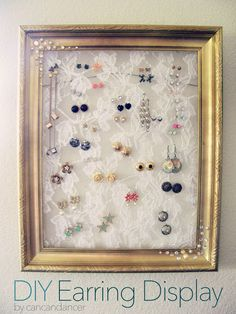 DIY Earring Display made with a frame, lace and a stapler.