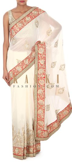 Buy this White saree adorn in zari and kundan embroidery only on Kalki
