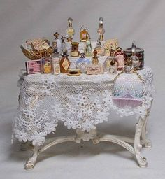 Dolls house miniature Ladies Victorian Perfumerie Table No. 9 by uniqueminiatures Victorian Dolls, Victorian Dollhouse, Miniature Furniture, Dollhouse Furniture, Dollhouse Interiors, Mini Doll House, Tiny World, Barbie Accessories, Needlepoint Kits