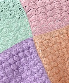 So many textures!  Caron International | Free Project | Sampler Squares Baby Blanket