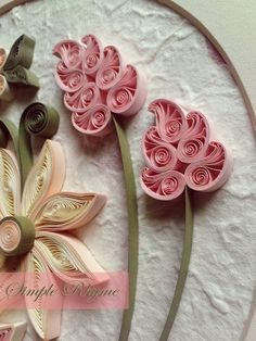 quilled flowers -- make paper for one of the hoops I just bought, add quilled flowers...