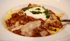 Pappardelle Bolognese | Rich ragu of ground beef, sweet Italian sausage and tomatoes over pappardelle pasta, topped with Burrata and cilantro pesto | Green Valley Grill Menu - Greensboro NC