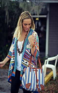 How to style a bohemian kimono jacket with layered necklaces and a boho designer bucket bag topped off with rugged leather boots.