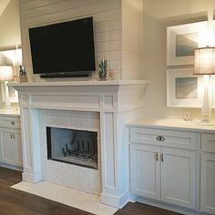 Trying to get some more interior pictures up... Here is a finished home with a shaker style mantel with a grooved siding chase. #fireplace #mantel #newconstruction #homebuilding
