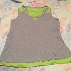 Workout shirt XL The inside of the shirt has a shelf bra all the way around the inside if of the shirt. Great for workouts. Athletech Tops Tank Tops