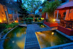 When designing your backyard, don't forget to carefully plan your lighting as well. Get great ideas for your backyard oasis here with our landscape lighting design ideas. Backyard Water Feature, Ponds Backyard, Fire Pit Landscaping, Front Yard Landscaping, Landscaping Ideas, Patio Ideas, Landscape Lighting Design, Modern Deck, Water Features In The Garden