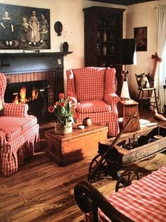 Home Design and Decor , Primitive Living Room Style : Primitive Living Room With Red Slipcovered Wingback Chairs And Trunk And Fireplace And Curio Cabinet And Wall Art Primitive Homes, Primitive Living Room, Primitive Furniture, Country Furniture, Primitive Country, Prim Decor, Country Decor, Primitive Decor, Primitive Curtains