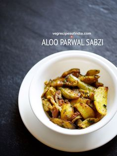 sukhi aloo parwal sabzi recipe with step by step photos - this aloo parwal recipe is a dry, slightly tangy and tasty dish made with potatoes (aloo) and pointed gourd (parwal).    this is a punjabi recipe