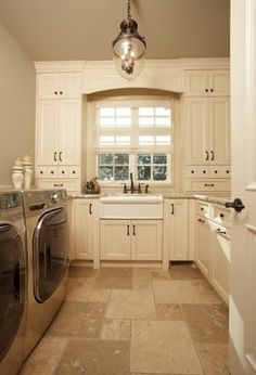The light-colored floor-to-ceiling cabinets work well in this small space. -Shirley