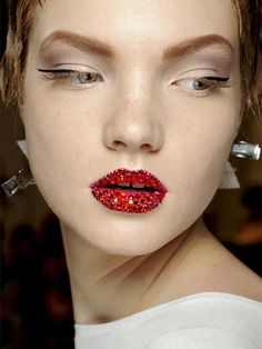Christian Dior S/S '13 Couture: http://beautyeditor.ca/2013/02/15/the-new-lip-texture-thats-about-to-take-off-and-5-cool-products-thatll-help-you-get-it/